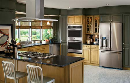 Dark Green Kitchen with GE Appliances in stainless steel.